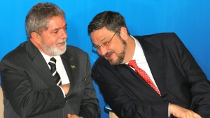 In this June 15, 2005 file photo, Brazil's President Luiz Inacio Lula da Silva, left, speaks with his Economy Minister Antonio Palocci during a ceremony at the presidential palace in Brasilia, Brazil. Palocci was arrested, police said on Monday, Sept. 26, 2016, the latest detention in connection with a wide-ranging investigation into a kickback scheme in state oil company Petrobras. (Eraldo Peres/AP)