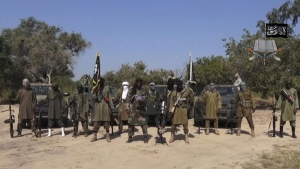 In this file image taken from video released Friday Oct. 31, 2014, by Boko Haram, Abubakar Shekau, centre, the leader of Nigeria's Islamic extremist group, surrounded by his fighters. Islamic extremists have killed eight soldiers and wounded 17 in two attacks in northeastern Nigeria, the country's military said Monday, Sept. 26, 2016. (Boko Haram/AP)