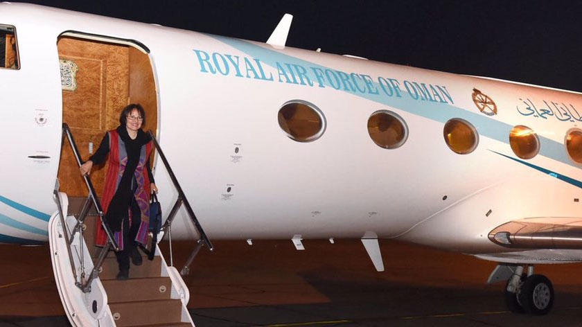 Canadian-Iranian professor Homa Hoodfar is seen departing a plane in this handout photo. (Public Authority for Radio and TV of Oman)