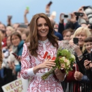 The Duchess of Cambridge as she receives flowers as she arrives at Jack Poole Plaza in Vancouver, B.C., Sunday, Sept. 25, 2016. (THE CANADIAN PRESS/Jonathan Hayward)