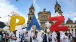 People hold up letters that form the word 'Peace' in Spanish during a gathering at Bolivar square in Bogota, Colombia, on Sept. 26, 2016. (Jennifer Alarcon / AP)