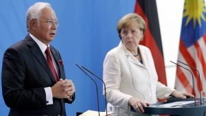 German Chancellor Angela Merkel, right, and Prime Minister of Malaysia Najib Razak, left, address the media during a joint press conference as part of a meeting at the chancellery in Berlin, Germany, Tuesday, Sept. 27, 2016. (Michael Sohn/AP)