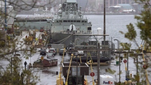Vehicles enter Canadian Forces Base Halifax, in Halifax, on October 22, 2014. (THE CANADIAN PRESS/Andrew Vaughan)