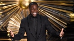 Kevin Hart speaks at the Oscars at the Dolby Theatre in Los Angeles on Feb. 28, 2016. Hart is literally laughing all the way to the bank. (Photo by Chris Pizzello/Invision/AP, File)