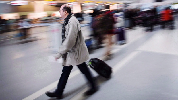 Air Canada, WestJet raising checked luggage fees
