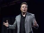 In this April 30, 2015 file photo, Elon Musk, CEO of Tesla Motors Inc., unveils the company's newest products, Powerwall and Powerpack in Hawthorne, Calif. (AP / Ringo H.W. Chiu)