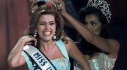 FILE - In this May 17, 1996, file photo, the new Miss Universe Alicia Machado of Venezuela reacts as she is crowned by the 1995 winner Chelsi Smith at the Miss Universe competition in Las Vegas. Machado became a topic of conversation during the first presidential debate between Republican nominee Donald Trump and Democratic candidate Hillary Clinton on Sept. 27, 2016. (AP Photo/Eric Draper, File)