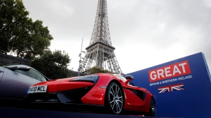 A MacLaren 570S is presented next to the Eiffel tower by The Society of Motor Manufacturers and Traders (SMMT), in Paris, Wednesday, Sept. 28, 2016. With the Paris Auto Show preparing to open, and British industry leaders gathering there Wednesday to boast of the strength of their brands, Britain's EU exit, or Brexit, remains vexing in part because it's still not clear exactly how the complex and highly globalized auto trade will be affected. (Christophe Ena/AP)