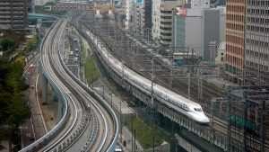 In this Sept. 24, 2014, file photo, a Shinkansen bullet train heads for Tokyo Station on the Tokaido Main Line in Tokyo. (Shizuo Kambayashi/AP)