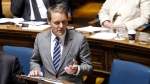 Manitoba's new Finance Minister Cameron Friesen reads his first provincial budget in the Manitoba Legislature in Winnipeg, Tuesday, May 31, 2016. (John Woods/THE CANADIAN PRESS)