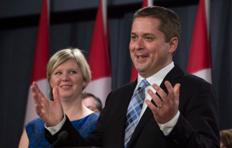 Jill Scheer looks on as her husband, Conservative MP Andrew Scheer, responds to a question after announcing he will run for the party leadership on Sept. 28, 2016 in Ottawa. (THE CANADIAN PRESS / Adrian Wyld)