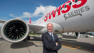 Bombardier CEO and President Alain Bellemare poses for a photograph next to a Bombardier C Series 100 with Swiss International Air Lines (SWISS) markings prior to a demonstration flight in Mirabel, Que., Wednesday, June 29, 2016. (THE CANADIAN PRESS / Graham Hughes)