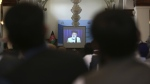 A screen shows the live broadcast of Gulbuddin Hekmatyar during a signing ceremony at the presidential palace in Kabul, Afghanistan on Thursday, Sept. 29, 2016. (AP / Rahmat Gul)
