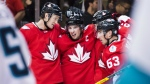 Team Canada captain Sidney Crosby celebrates with teammates Jay Bouwmeester and Brad Marchand after a goal by teammate Patrice Bergeron against team Europe during third period World Cup of Hockey action finals in Toronto on Tuesday, Sept.27, 2016. (Nathan Denette / THE CANADIAN PRESS)