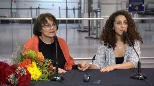 Canadian-Iranian professor Homa Hoodfar, left, speaks after landing in Montreal on Thursday, Sept. 29, 2016.
