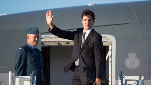 Canadian Prime Minister Justin Trudeau boards a government plane in Ottawa, Thursday September 29, 2016. (Adrian Wyld/The Canadian Press)