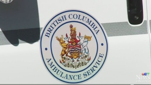 The British Columbia Ambulance Service emblem is shown on the side of an ambulance.