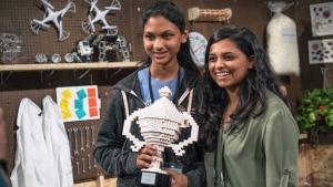 Google Science Fair grand prize winner Kiara Nirghin of Johannesburg stands beside the 2011 winner Shree Bose. (Google)