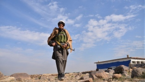An Afghan militia man walks in the Achin district of Nangarhar province east of Kabul, Afghanistan, Sunday, Dec. 27, 2015. (Mohammad Anwar Danishyar/AP)