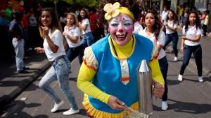 A clown dances during a march in downtown Guatemala City, on April 13, 2016. (Moises Castillo / AP)
