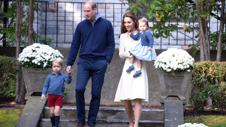 Prince William, and his wife Kate, the Duke and Duchess of Cambridge, arrive at a tea party with their children Prince George and Princess Charlotte at Government House in Victoria, Sept. 29, 2016. (Jonathan Hayward / The Canadian Press)