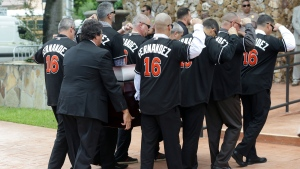Pallbearers wear a No. 16 jersey in honor of Miami Marlins pitcher Jose Fernandez as they carry his casket for a memorial service at St. Brendan's Catholic Church, Thursday, Sept. 29, 2016, in Miami. (AP Photo/Lynne Sladky)