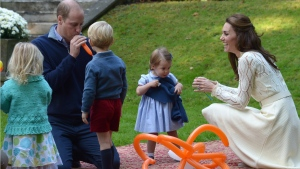 Prince William blows up a balloon as he and his wife Kate, the Duchess of Cambridge, take part in a tea party with their children, Prince George and Princess Charlotte, at Government House in Victoria, Thursday, Sept. 29, 2016. (THE CANADIAN PRESS/Jonathan Hayward_