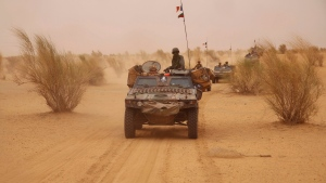 In this photo taken June 24, 2015, French forces patrol in the desert of Northern Mali along the border with Niger on the outskirts of Asongo, Northern Mali. (AP Photo/Maeva Bambuck )