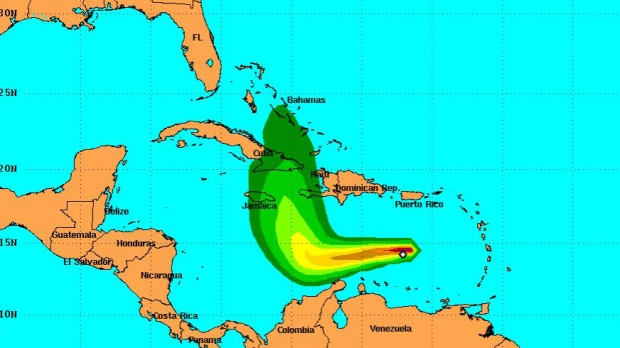 This projection from the U.S. National Hurricane Center shows the probably of hurricane-strength wind speeds over the next five days, from 5-10% (dark green) to 90-100% (purple), starting at 2 p.m. EST, on Thursday, Sept. 29, 2016.