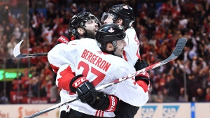 Team Canada's Patrice Bergeron (37) celebrates his goal against Team Europe with teammates Brent Burns (88) and Steven Stamkos (91) during third period World Cup of Hockey finals action in Toronto on Thursday, September 29, 2016. (THE CANADIAN PRESS / Frank Gunn)