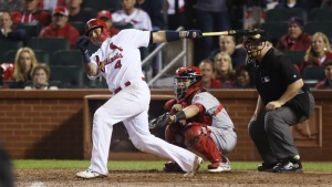 St. Louis Cardinals' Yadier Molina hits a double to drive in the game-winning run against the Cincinnati Reds in a baseball game at Busch Stadium in St. Louis on Thursday, Sept. 29, 2016. (Chris Lee / St. Louis Post-Dispatch)