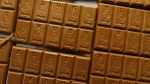 Candy bars marked with Colorado's new required diamond-shaped stamp noting that the product contains marijuana are shown in the kitchen of BlueKudu candy in the historic Five Points District of Denver on Monday, Sept. 19, 2016. (AP / David Zalubowski)