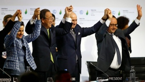 In this Dec. 12, 2015, file photo, French President Francois Hollande, right, French Foreign Minister and president of the COP21 Laurent Fabius, second right, United Nations climate chief Christiana Figueres, left, and United Nations Secretary General Ban Ki-moon hold their hands up in celebration after the final conference at the COP21, the United Nations conference on climate change, in Le Bourget, north of Paris.(Francois Mori/AP)