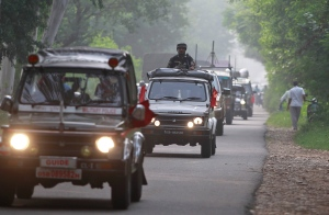 An Indian army convoy moves near the highly militarized Line of Control dividing Kashmir between India and Pakistan, in Akhnoor, some 62 kilometers from Jammu, India, Friday, Sept. 30, 2016. (AP Photo/Channi Anand)