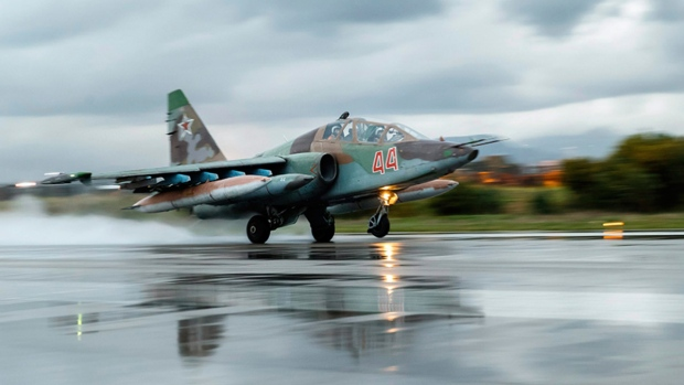 Russian Su-25 ground attack jet takes off at Hemeimeem Air Base in Syria, on March 16, 2016. (Russian Defense Ministry Press Service via AP)