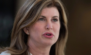 Opposition leader Rona Ambrose speaks with media following the burial of former President Shimon Peres in Jerusalem, Israel Friday September 30, 2016. (THE CANADIAN PRESS/Adrian Wyld)