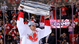 Team Canada's Sidney Crosby (87) hoists the trophy following his team's victory over Team Europe during World Cup of Hockey finals action in Toronto on Thursday, September 29, 2016. THE CANADIAN PRESS/Bruce Bennett/POOL