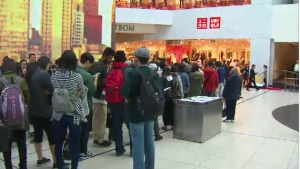 Shoppers gathered outside the new Uniqlo retail store at Toronto Eaton Centre, which opened on Friday, Sept. 30, 2016.