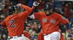 Boston Red Sox designated hitter David Ortiz, right, celebrates his two-run home run with Xander Bogaerts (2) during the seventh inning of a baseball game against the Toronto Blue Jays at Fenway Park, Friday, Sept. 30, 2016, in Boston. (AP / Elise Amendola)