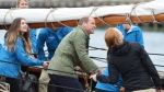 The Duke of Cambridge helps to hoist the sails on a tallship, in Victoria on Saturday, October 1, 2016. (THE CANADIAN PRESS / Jonathan Hayward)