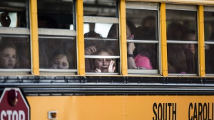 Townville Elementary students look out of the window of a school bus as they are transported to Oakdale Baptist Church, following a shooting at their school in Townville, S.C., on Wednesday, Sept. 28, 2016. (Katie McLean/The Independent-Mail via AP)