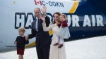 The Duke and Duchess of Cambridge along with their children Prince George and Princess Charlotte get on a float plane as they prepare to depart Victoria, B.C. Saturday, Oct. 1, 2016. THE CANADIAN PRESS/Jonathan Hayward