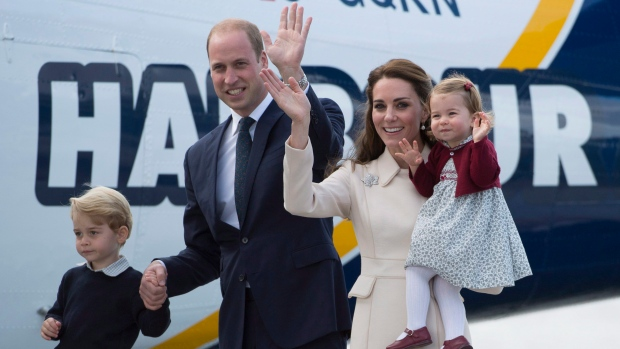 The Duke and Duchess of Cambridge along with their children Prince George and Princess Charlotte get on a float plane as they prepare to depart Victoria, B.C. Saturday, Oct. 1, 2016. (THE CANADIAN PRESS / Jonathan Hayward)