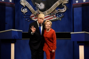 In this photo provided by NBC, Alec Baldwin, left, as Republican presidential candidate, Donald Trump, and Kate McKinnon, as Democratic presidential candidate, Hillary Clinton, perform during the 'Debate Cold Open' sketch on the 42nd season of 'Saturday Night Live,' in New York, Saturday, Oct. 1, 2016. (Will Heath)