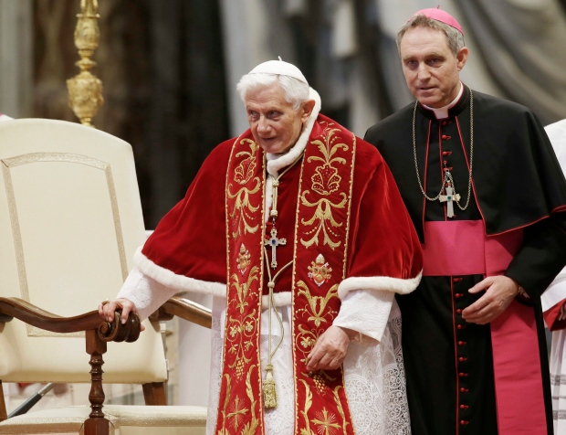 This Feb. 9, 2013 file photo shows Pope Benedict XVI flanked by personal secretary Archbishop Georg Gaenswein during a Mass to mark the 900th anniversary of the Order of the Knights of Malta in St. Peter's Basilica at the Vatican. (AP /Gregorio Borgia)