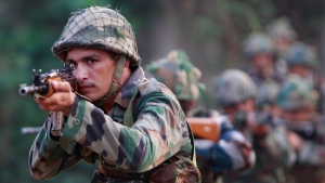 Indian army soldiers take positions during their patrol near the Line of Control in Nowshera sector, about 90 kilometres from Jammu, India, Sunday, Oct. 2, 2016. (AP / Channi Anand)