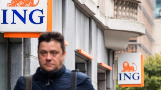 A man walks by an ING bank branch in Brussels, on Oct. 3, 2016. (Geert Vanden Wijngaert / AP)