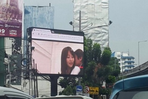 Police in Indonesia's capital are investigating the operator of a public video screen after it displayed a porn movie instead of advertising to passing traffic. (@AuskarSurbakti/Twitter)