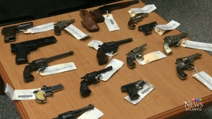 Guns traded in for transit fares are displayed in Halifax. (CTV Atlantic)