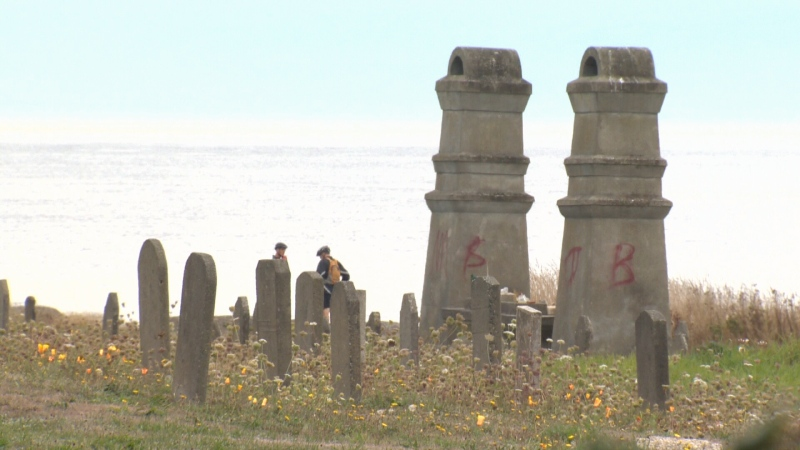 The twin towers of the ceremonial altar, used for burning incense and for offerings of food were tagged with spray paint last week. (CTV Vancouver Island)